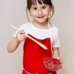 Little girl preparing some dessert — Stock Photo