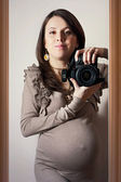 Beautiful pregnant woman taking self-portrait  — Stock Photo