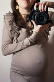 Image of pregnant woman taking self-portrait  — Stock Photo