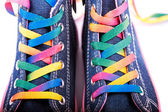 Closeup of a sneakers with colored shoelaces — Stock Photo