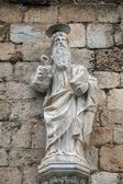 Statue of God the Father on the portal of the Franciscan church of the Friars Minor in Dubrovnik — Stock Photo