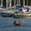 Small boat coming in full marina — Lizenzfreies Foto
