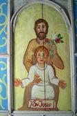 Saint Joseph holding baby Jesus — Stock Photo
