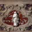 Virgin Mary detail of the medieval church altar - Stock Photo