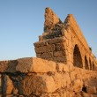 Ancient Roman aqueduct at Caesarea, in Israel. - Stock Photo