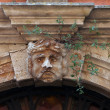Stucco mask on the facade - Stock Photo