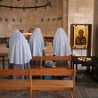 View of praying nuns - Stock Photo