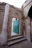 Tür im äthiopischen stams, kirche des heiligen sepulchre, jerusalem, israel — Stockfoto