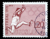 Stamp printed in Yugoslavia shows olympic games in Montreal — Stockfoto