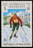 Stamp printed by Maldives, shows Alpine skiing at the Winter Olympics in Innsbruck — Stock Photo