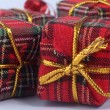 Red gift with gold bow — Stock Photo #15554129
