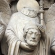 Saint Denis holding his head, Notre Dame Cathedral, Paris - Stock Photo