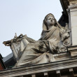 Statue of industry on the BNP building in Paris — Stock Photo
