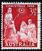 Uma saudação selo natal impresso em austrália mostra o nascimento de jesus cristo, por volta de 1958 — Fotografia Stock