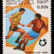 Stamp printed in LAOS shows the Soccer Players — Stock Photo