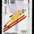 Stamp printed in Cambodia shows image of ski jumper on occasion of the Olympic games in Sarajevo — Zdjęcie stockowe