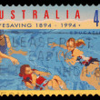 Stamp printed in AUSTRALIA shows the in Water, Centenary of Organized Life-saving in Australia — Foto de Stock
