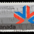Stamp printed in Canada shows a symbol of XI Commonwealth Games — Stock Photo