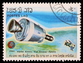 Stamp printed in Laos shows experimental flight of Soyuz and Apollo — Stock Photo