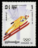 Stamp printed in Cambodia shows image of ski jumper on occasion of the Olympic games in Sarajevo — Stock Photo