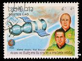 Stempel gedruckt in laos zeigt sojus 19 und besatzung a. leonow und v. kubassow — Stockfoto