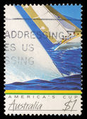 Stamp printed in Australia shows image of a yacht competing the America's Cup — Stock Photo