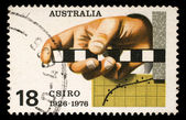Stamp printed in AUSTRALIA shows the Survey Rule, Graph, Punched Tape, Commonwealth Scientific and Industrial Research Organization, 50th anniversary — Stock Photo