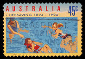 Stamp printed in AUSTRALIA shows the in Water, Centenary of Organized Life-saving in Australia — Stock Photo