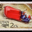 Постер, плакат: Stamp printed in Bhutan shows four man bobsleigh at the Olympic Winter Games in Innsbruck