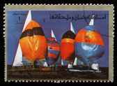 Stamp printed in the Ajman shows Sailing, Summer Olympics — Стоковое фото