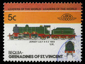 Stamp printed in Grenadines of St. Vincent shows Jersey Lily Train 4-4-2, 1903 U.K — Stock Photo