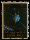 Stamp printed in United Arab Emirates (UAE) shows Explorer 17 series satellites — Foto de Stock