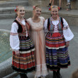 Members of the ensemble song and dance Warsaw School of Economics in Polish national costume — Stock Photo