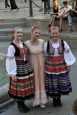 Members of the ensemble song and dance Warsaw School of Economics in in old style costumes — Stock Photo