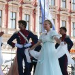 Stock Photo: Members of ensemble song and dance Warsaw School of Economics in in old style costumes