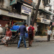 Rickshaw mwaits for customers on streets, Kolkata, India — Foto de stock #32049947