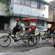 Stock Photo: Rickshaw mwaits for customers on streets of Kolkata, India