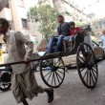 Rickshaw man pulls the customer in the streets of Kolkata, India — Stock Photo #32078171