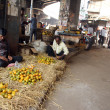 Stock Photo: Seller sells fruits on outdoor market, Kolkata, India