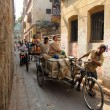 Stock Photo: Rickshaw-puller carrying goods on road of Kolkata, India