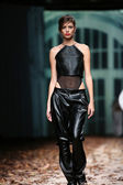 Fashion model wearing clothes designed by Manuel Maligec on the Cro a Porter show — Stock Photo