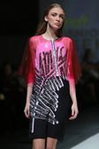 Fashion model wearing clothes designed by Kitty Joseph on the Zagreb Fashion Week show — Stock Photo