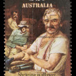 Stock Photo: Stamp printed in Australishows sheepshearing