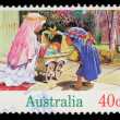 Stamp printed in Australia shows children playing to the Holy Family — Stock Photo
