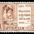 Australian postage stamp shows The Holy Virgin Mary and baby Jesus — Stock Photo #37547491