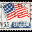 Stamp printed in the United States features waving US flag — Foto Stock