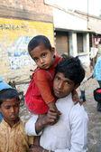 Alindra Jana holding his little sister Sabita, at remote village Kumrokhali, West Bengal, India — Stock Photo