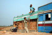 Brick field workers carrying complete finish brick from the kiln, and loaded it onto a truck — Stock Photo