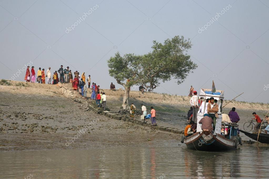 Gosaba India  city photo : Wooden boat crosses the Ganges River in Gosaba, West Bengal, India ...