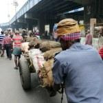 ������, ������: Hard working Indians pushing heavy load through streets in Kolkata